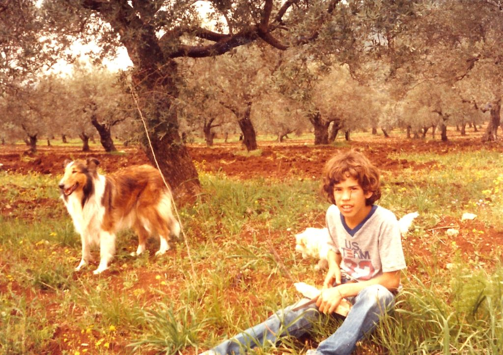 guy with family dog jeans. itzik wrote a children book about her.