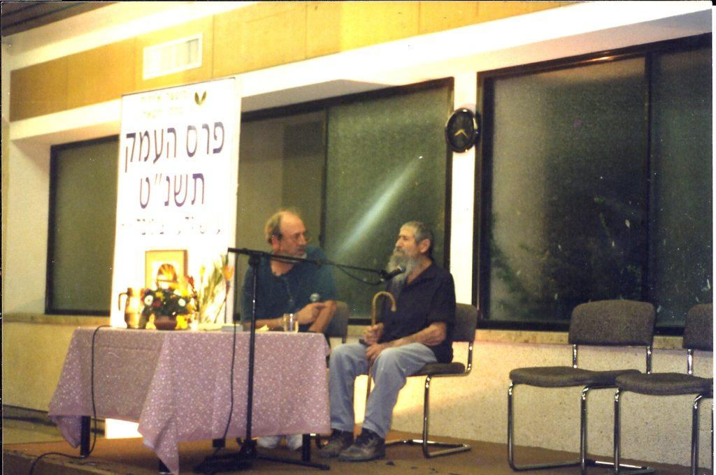 talking with elyahu amitzur, one of kfar yehoshua, while elihu recieved the emek izrael prize